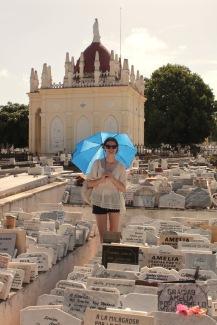 Girl with umbrella at Necropolis Cristobal Colon