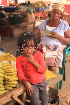 Little girl with bananas at Inhambane market
