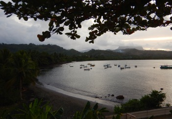 View over Baracoa port with fishing boats and El Yunque