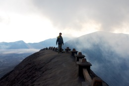 Man standing on the lip of Bromo volcano