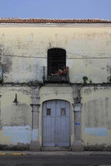 Man on his balcony in Camaguey Cuba