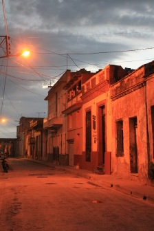Camaguey street by night with red streetlights