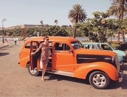 Orange classic car taxi in Havana