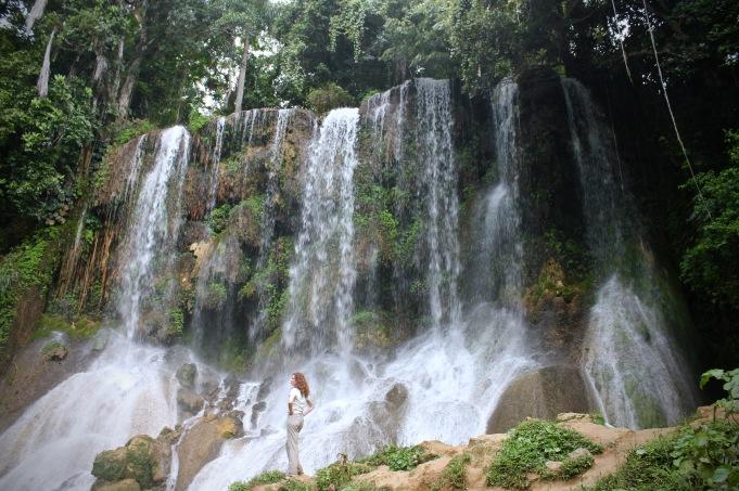 Girl standing in front of El Nicho waterfall, Cienfuegos Cuba