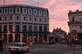 Hotel Telegrafo against a pink sunset sky, Havana