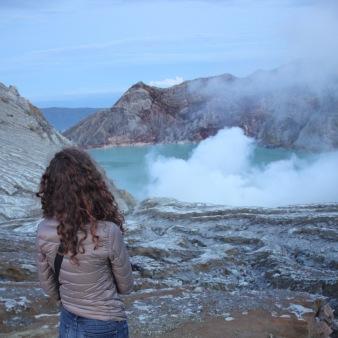 Girl looking at Kawah Ijen crater lake