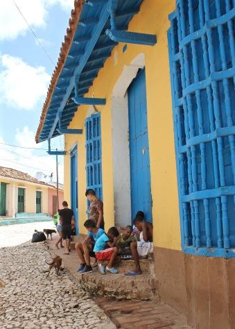 Kids playing checkers on the street, Trinidad Cuba