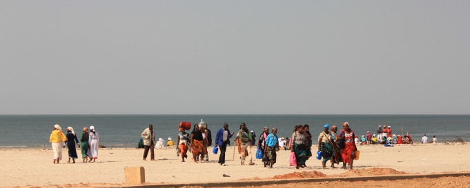 Maputo beach with colourful locals