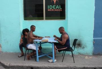 Men playing dominoes on the street, Santiago de Cuba