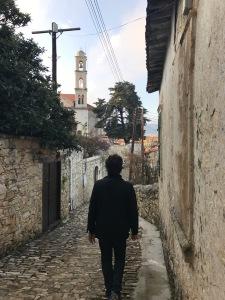 Man walking in a narrow street in Lofou Cyprus