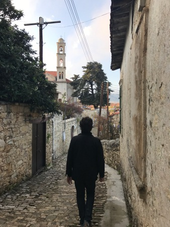 Man walking in a narrow street in Lofou Cyprus
