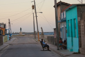 Man on a rocking chair on a street in Gibara Cuba