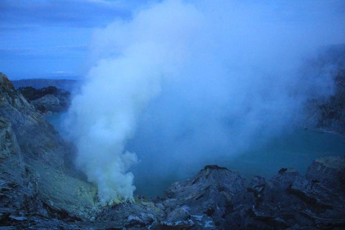Sulphur fumes over Kawah Ijen crater lake at daybreak