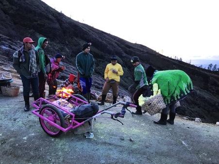 Sulphur miners on the lip of Kawah Ijen volcano
