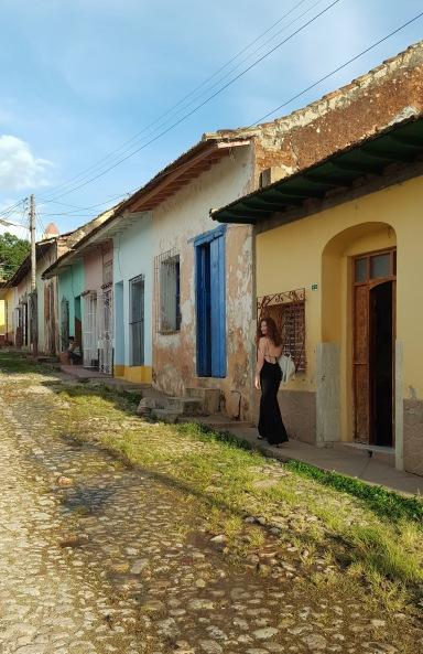 Girl walking on the streets of Trinidad Cuba