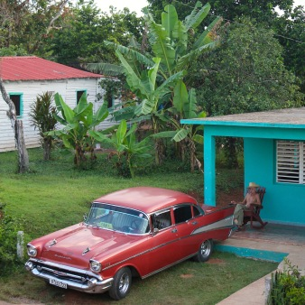 Cuban man and his classic car in Vinales
