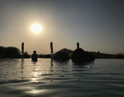 The sun shines over the pool at Telal Resort UAE