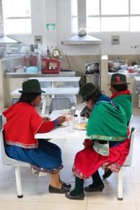 Indigenous Ecuadorian woman having lunch at the Mercado
