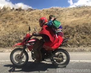 Locals on a motorcycle, Ecuador