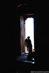 Ethiopian priest standing in the doorway of his church
