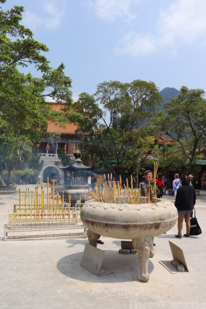 Offering incense in front of Po Lin Monastery, Lantau Island