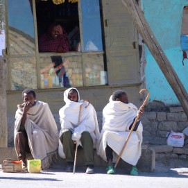 Three Ethiopian men waiting by the road