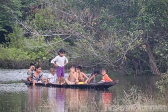 Children playing on a canoe near Kwatamang Landing Guyana