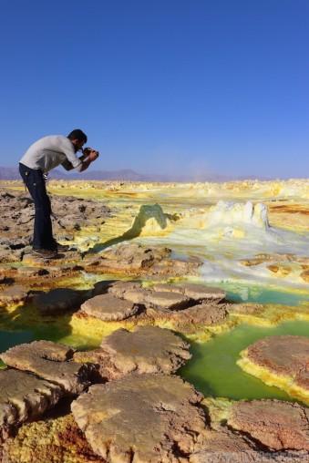 Photographer at Dallol hot springs, Danakil Depression Ethiopia