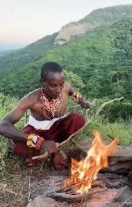 Samburu askari making a campfire near Kitich, Mathews Mountain Range Kenya