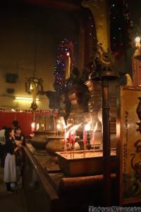 Women leaving incense at Man Mo Temple Hong Kong