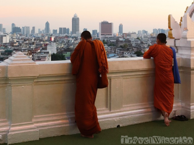 Buddhist monks on top of Wat Saket