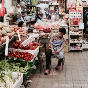 Saleswoman napping at Causeway Bay Market Hong Kong