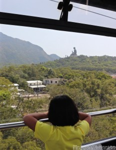 Girl in the Ngong Ping 360 cable car to Tian Tan Buddha