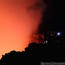 People standing on the rim of Erta Ale lava lake