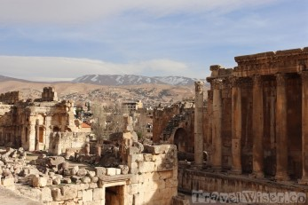 Baalbek temples with the city and snowy mountains in the background