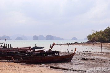 Fishing boats on a Koh Yao Noi beach at low tide